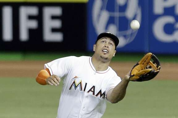 Miami Marlins right fielder Giancarlo Stanton catches a fly ball by Atlanta Braves' Mallex Smith during the ninth inning of a baseball game, Friday, April 15, 2016, in Miami. The Braves won 6-3. (AP Photo/Alan Diaz)