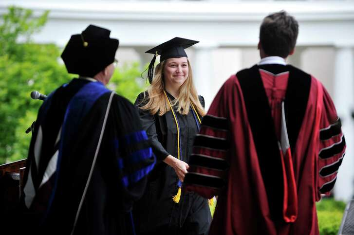 Nicole Casper receives her diploma this June at Union College in Schenectady, N.Y. Columnist Scott Burns has an idea to shrink a growing student debt crisis.