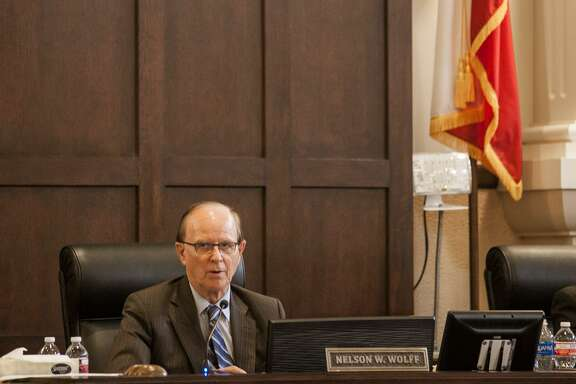 """Our jail's jammed up. We're paying for 100 prisoners to be boarded somewhere else daily,"" County Judge Nelson Wolff said before the meeting. The new budget includes a $4 million spending increase to cover housing inmates out of county and overtime for employees at the county jail."