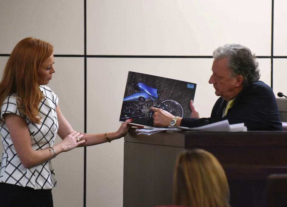 Defense attorney Leigh Cutter asks Charles Ruble, an accident analyst, about a photograph of Bill Hall Jr.'s wrecked motorcycle during the murder trial of his wife, Frances Hall. Photo: Billy Calzada /San Antonio Express-News / San Antonio Express-News