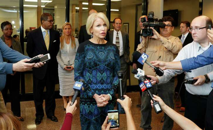 Dallas County District Attorney Susan Hawk, shown at a 2015 news conference outside of her office in Dallas, has spoken publicly about her battles with depression and anxiety. She resigned her office on Tuesday,  a month after returning to work following her third inpatient treatment for mental illness.