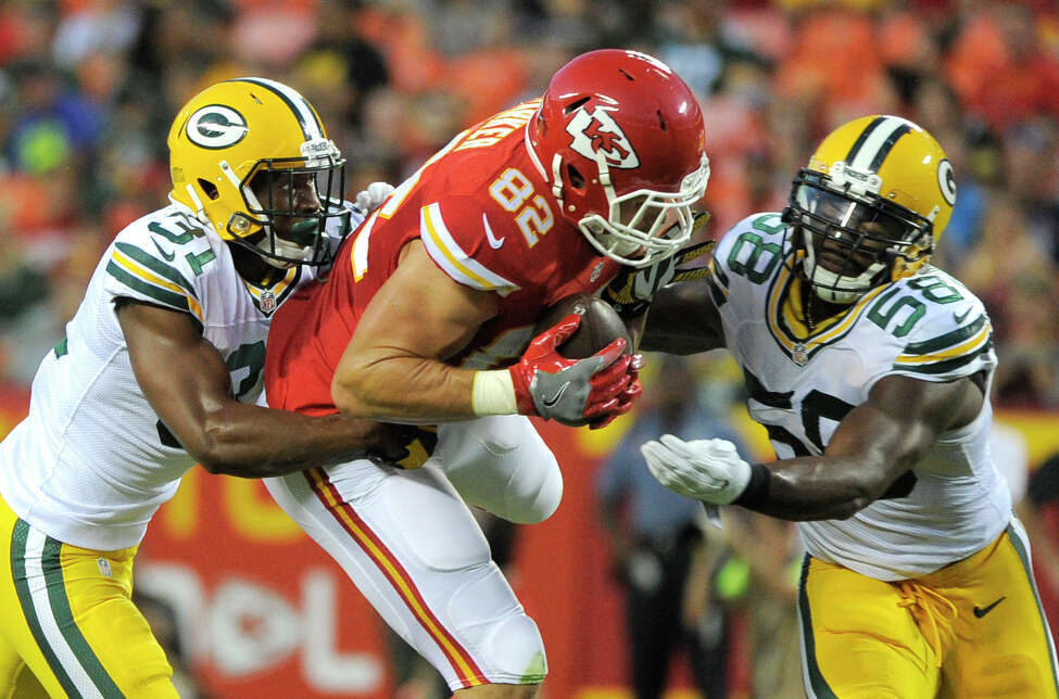 Kansas City Chiefs tight end Brian Parker (82) is tackled by Green Bay Packers linebacker Sam Barrington (58) and cornerback Robertson Daniel, left, during the first half of an NFL preseason football game in Kansas City, Mo., Thursday, Sept. 1, 2016. (AP Photo/Ed Zurga) ORG XMIT: MONH123