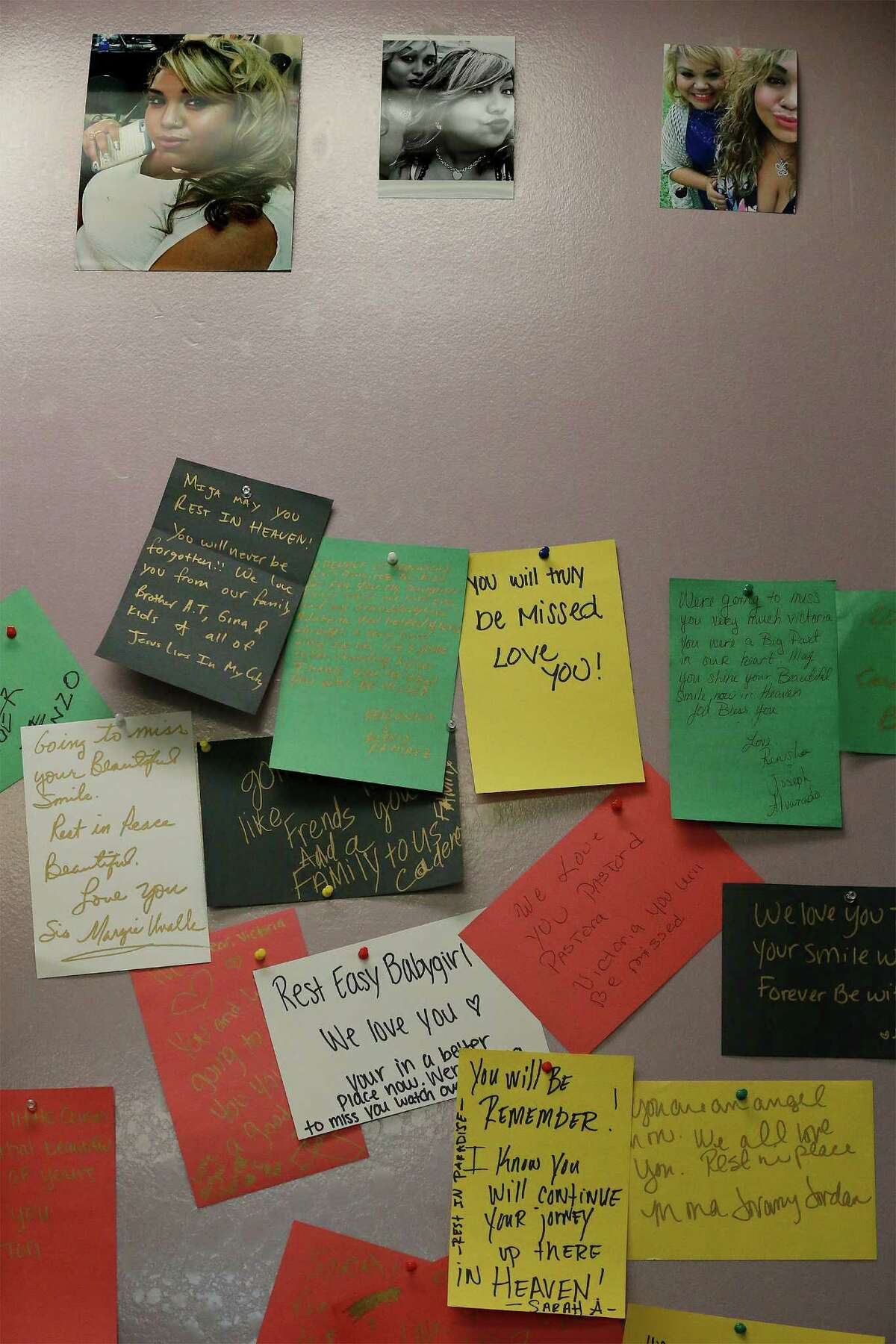 A memorial board with messages left by mourners is seen as hundreds attend a prayer service and candlelight vigil at Last Chance Ministries for Victoria Robles who was killed in an auto accident early Tuesday near Southeast Loop 410. Two children were also fatalities in the accident. Robles' father whom the congregation call Pastor Jimmy has led the church at 404 Brady Boulevard for the past 5 years. After a sermon, mourners were led outside to light candles to remember the outgoing 19-year-old girl. After a prayer, balloons were then released as mourners said aloud,