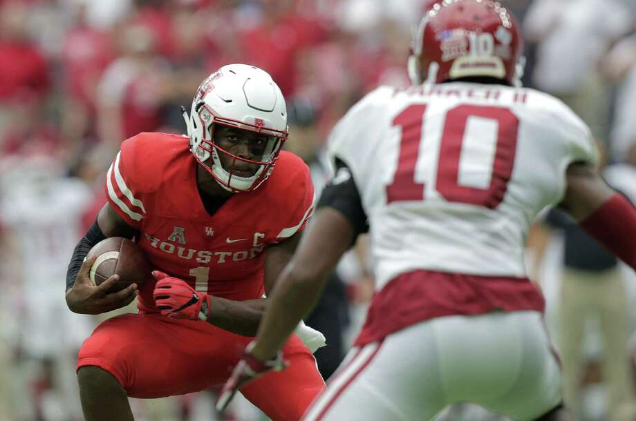 After throwing the ball 40 times and running another 18 against Oklahoma, UH quarterback Greg Ward Jr. could get a Saturday off against Lamar to let his sore shoulder heal. Photo: Elizabeth Conley, Staff / © 2016 Houston Chronicle