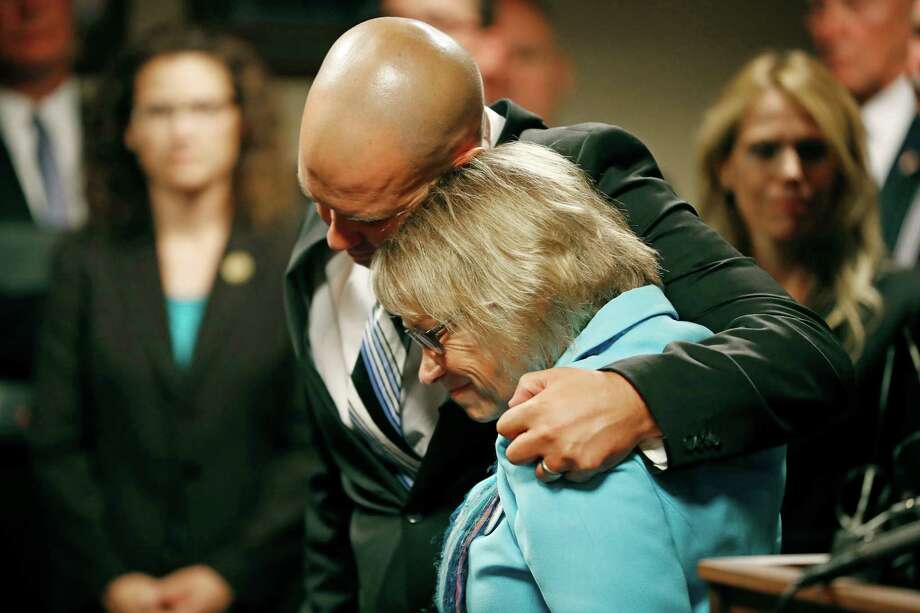 """Patty Wetterling is consoled by son Trevor during a news conference after a hear for Danny Heinrich, Tuesday, Sept. 6, 2016 in Minneapolis. Heinrich confessed Tuesday to abducting and killing 11-year-old Jacob Wetterling nearly 27 years ago, recounting a crime that long haunted the state with details that included Jacob asking right after he was taken: """"What did I do wrong?"""" (Jerry Holt/Star Tribune via AP) Photo: Jerry Holt, MBO / Star Tribune"""