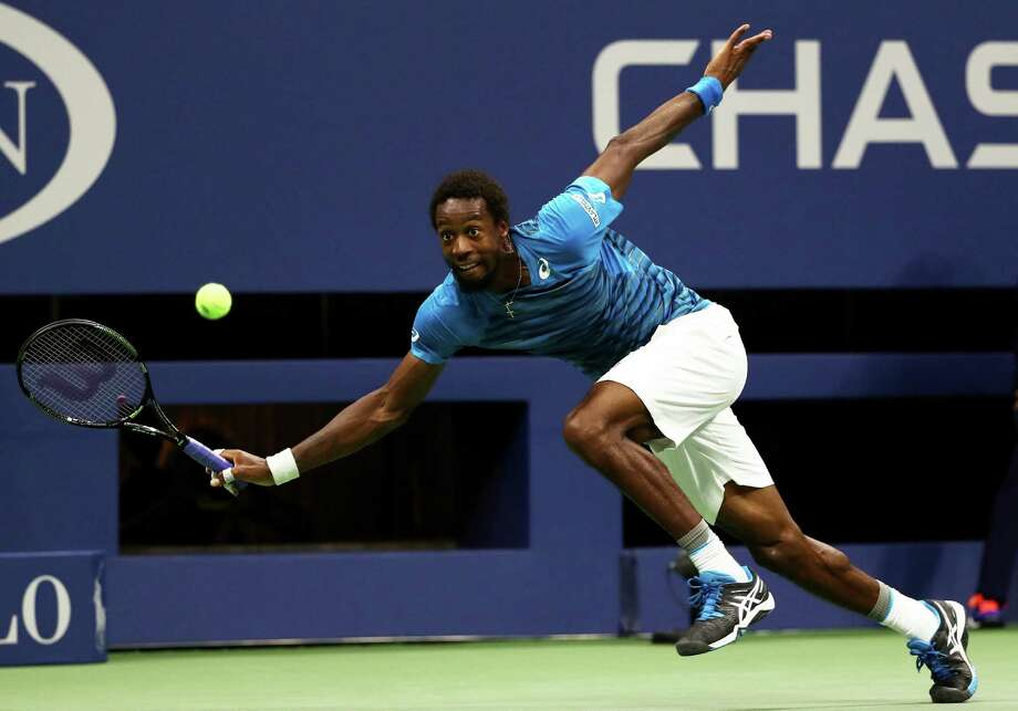 *** BESTPIX *** NEW YORK, NY - SEPTEMBER 06:  Gael Monfils of France returns a shot to Lucas Pouille of France during their Men's Singles Quarterfinal Match on Day Nine of the 2016 US Open at the USTA Billie Jean King National Tennis Center on September 6, 2016 in the Flushing neighborhood of the Queens borough of New York City.  (Photo by Elsa/Getty Images) Photo: Elsa, Staff / 2016 Getty Images