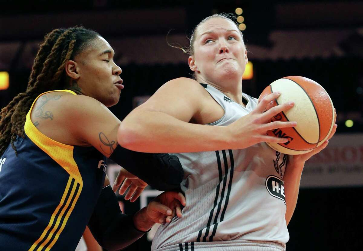 Center Jayne Appel-Marinelli muscles her way through the paint against Erlang Larkins as the Stars host Indiana at the AT&T Center on Sept. 6, 2016.