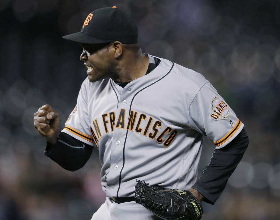 San Francisco Giants relief pitcher Santiago Casilla reacts after getting Colorado Rockies' Gerardo Parra to ground into a double play to end a baseball game Tuesday, Sept. 6, 2016, in Denver. The Giants won 3-2. (AP Photo/David Zalubowski) Photo: David Zalubowski, Associated Press