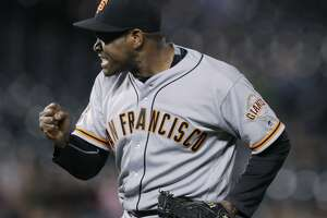 San Francisco Giants relief pitcher Santiago Casilla reacts after getting Colorado Rockies' Gerardo Parra to ground into a double play to end a baseball game Tuesday, Sept. 6, 2016, in Denver. The Giants won 3-2. (AP Photo/David Zalubowski)