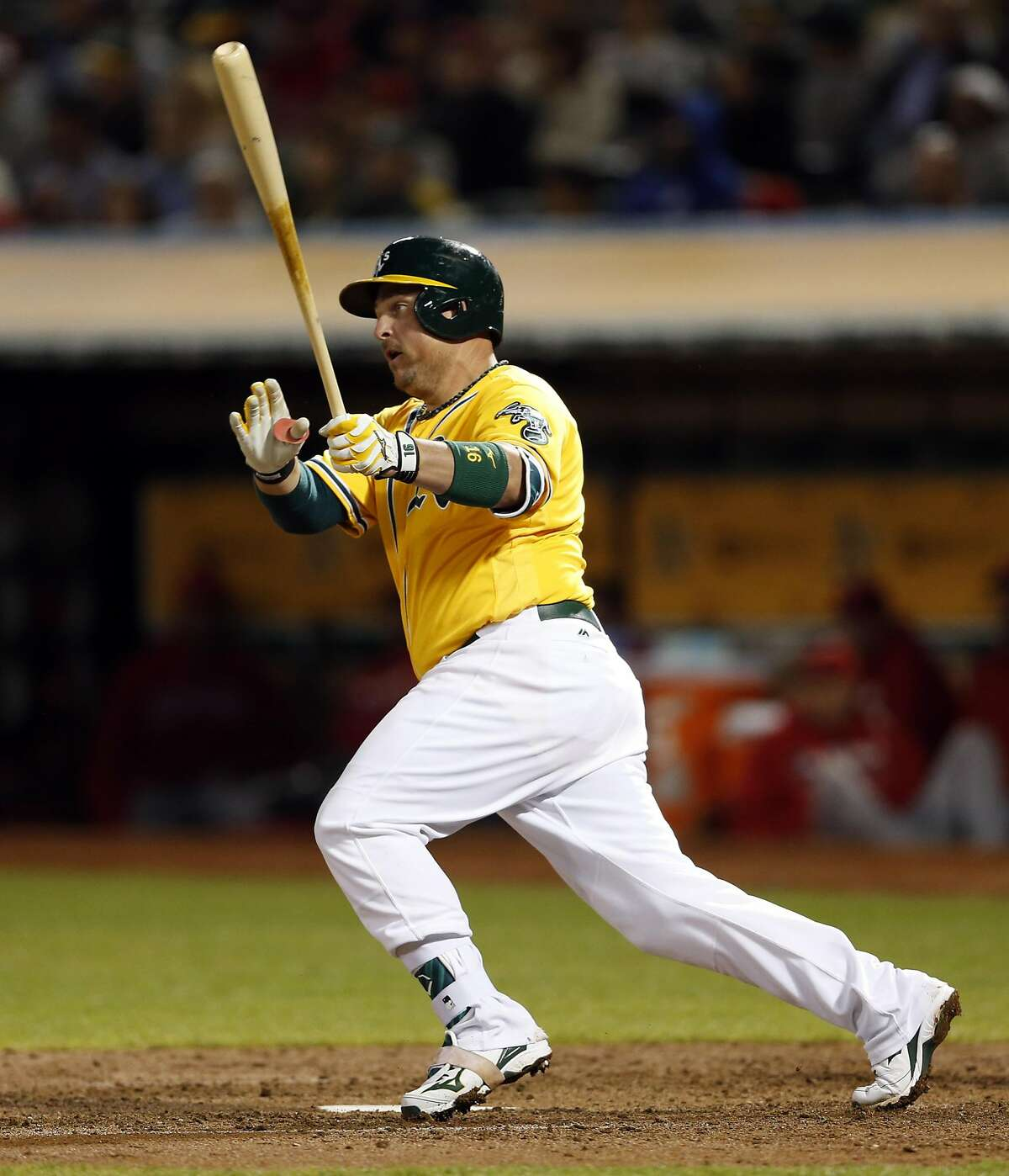Oakland Athletics' Billy Butler singles in 8th inning of A's 3-2 win over Los Angeles Angels in MLB game at Oakland Coliseum in Oakland, Calif., on Tuesday, September 6, 2016.