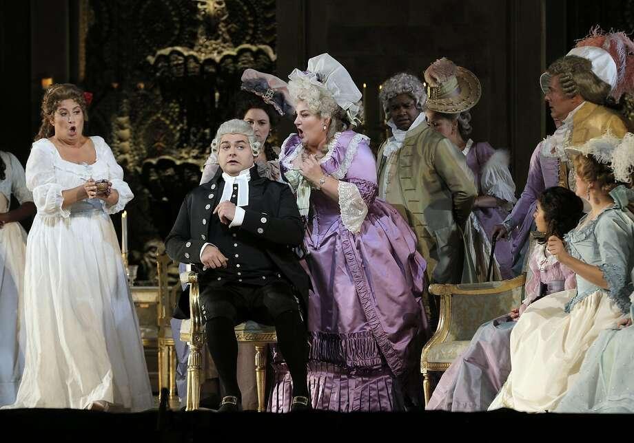 """Maddalena di Coigny (Anna Pirozzi, left), the Abbe (Alex Boyer) and the Contessa di Coigny (Catherine Cook) sing in """"Andrea Chénier,"""" which opened the S.F. Opera season. Photo: Carlos Avila Gonzalez, The Chronicle"""