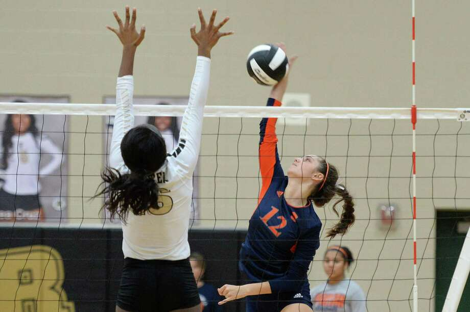 Sept. 6: Seven Lakes def. Foster 20-25, 25-10, 25-16, 25-17Natalie Pashby (12) of Seven Lakes reaches for a kill shot during the third set of a non-district volleyball game between the Seven Lakes Spartans and Foster Falcons on September 6, 2016 at Foster High School, Richmond, TX. Photo: Craig Moseley, Houston Chronicle / ©2016 Houston Chronicle