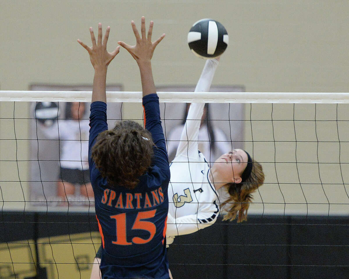 Catherine Krieger (3) of Foster goes for a kill shot against Keziah Williams (15) of Seven Lakes during the third set of a non-district volleyball game between the Seven Lakes Spartans and Foster Falcons on September 6, 2016 at Foster High School, Richmond, TX.