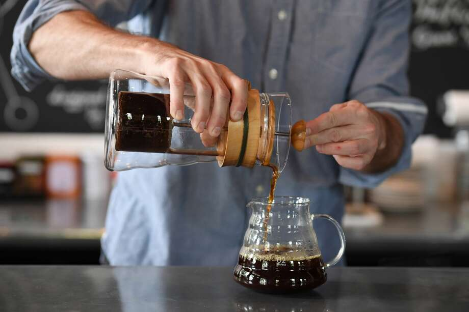 Matt McGuire, coffee director at the Coffee Bar in Washington, demonstrates the process for cold-brew coffee concentrate on September 1, 2016, in Washington, D.C. Photo: Matt McClain/The Washington Post