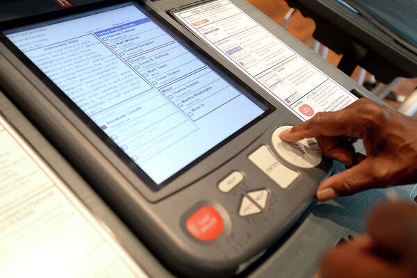 The public was invited to try out the Jefferson County Clerk's new voting machines during an open training session  at the courthouse Wednesday. The equipment will be put into use for the first time in the May 9th election. The machines do not require calibration like the older touch screen models and are easily navigable using a wheel and buttons. They also rate high for accuracy and will make the final tallying and reporting process easier for election workers, as well. They are currently being used in about 40% of Texas precincts. Photo taken Tuesday, April 7, 2015 Kim Brent/The Enterprise