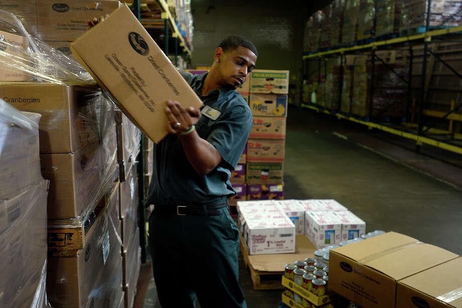 Ramon Mouton moves boxes of food in the warehouse at the Southeast Texas Food Bank on Tuesday.  Photo taken Tuesday 9/6/16 Ryan Pelham/The Enterprise Photo: Ryan Pelham / ©2016 The Beaumont Enterprise/Ryan Pelham