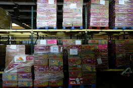 Cases of food and other items stacked on pallets at the Southeast Texas Food Bank on Tuesday.  Photo taken Tuesday 9/6/16 Ryan Pelham/The Enterprise