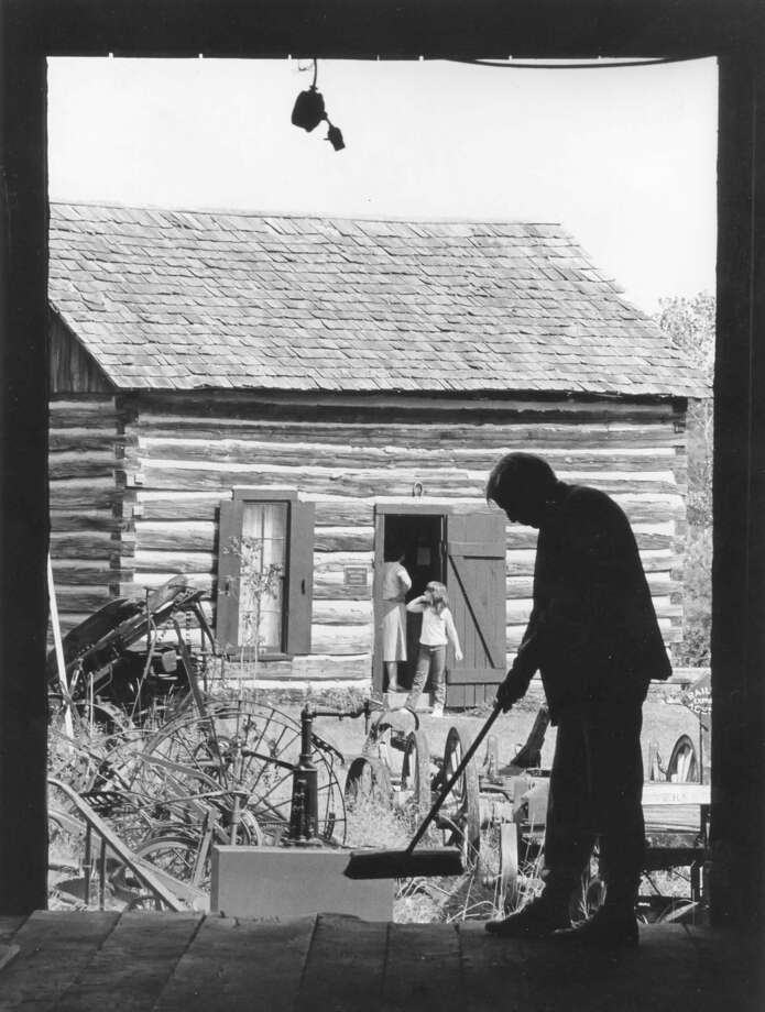 Don Marquardt of Sanford is shown in silhouette sweeping out the train depot located on the grounds of the Sanford Area Museum. September 1987 Photo: Daily News File Photo