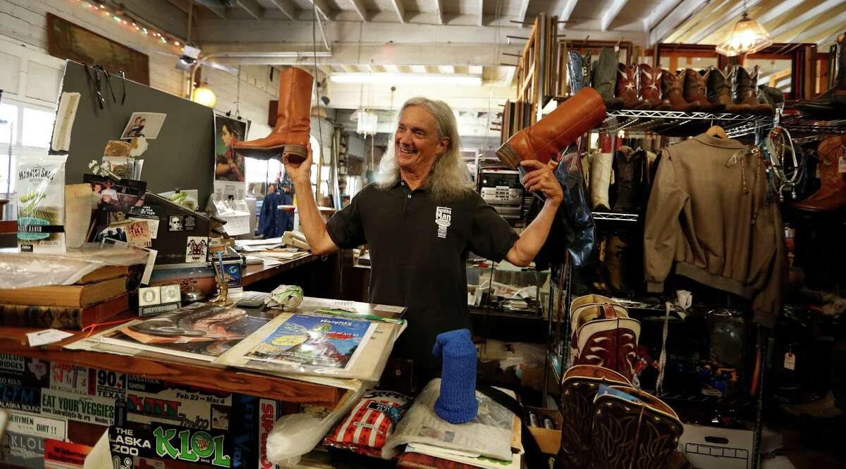 Bob Novotney chats with customers at Texas Junk Company, which may be leaving its longtime Montrose location, at 215 Welch, on Oct. 1.