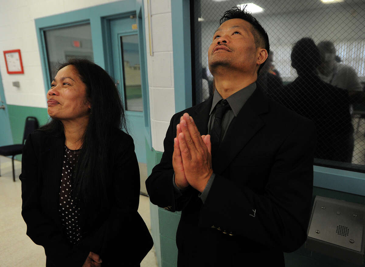 Chan Prum, left, and Song Krom, parents of Panna Krom, react after she was granted clemency during a hearing at the York Correctional Institution in Niantic, Conn. on Wednesday, September 7, 2016. Krom, who served almost ten years for killing her newborn daughter, will be released from prison at the end of September.
