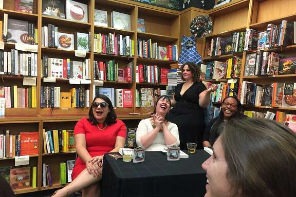 Amy Stephenson, in the black dress, oversees erotic fan fiction events at Booksmith
