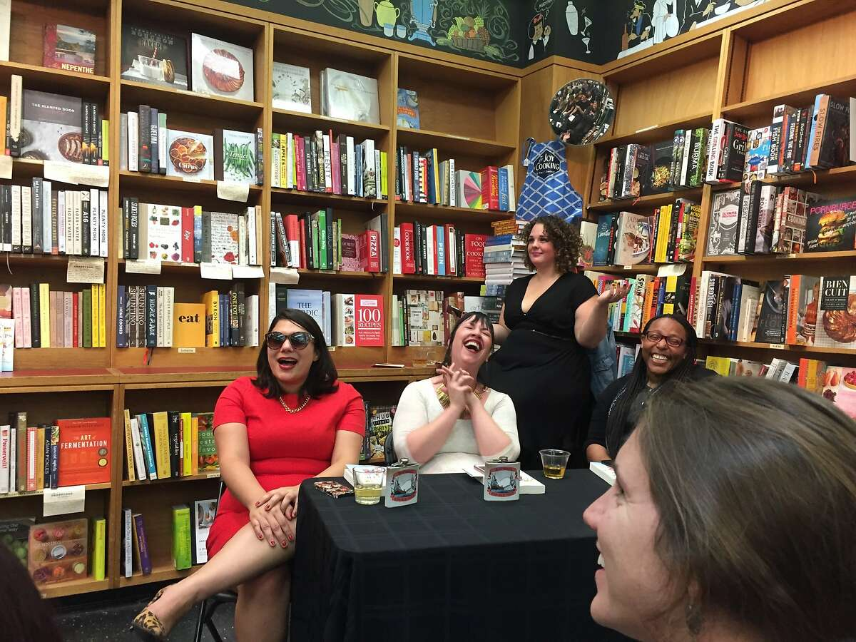 Amy Stephenson, in the black dress, oversees erotic fan fiction events at Booksmith.