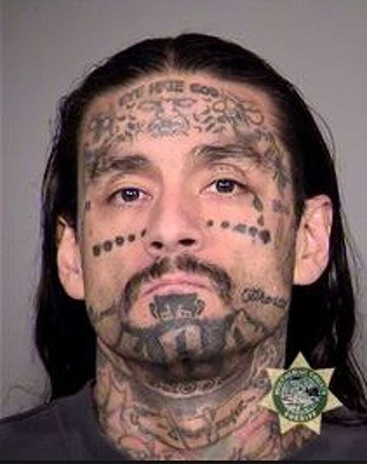 Oregon gangster gets years for sanding off man s tattoo