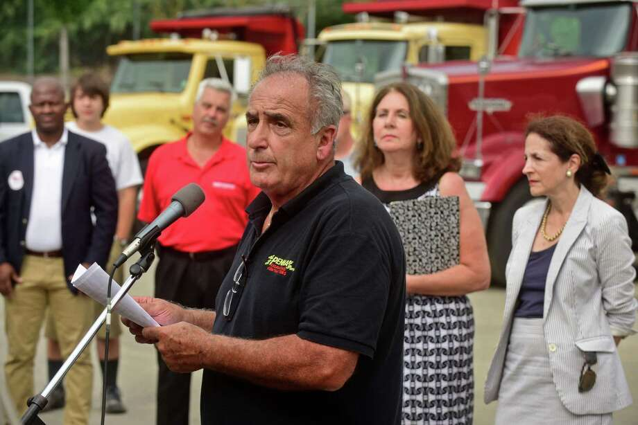 Vinny Penna, owner of Penna Construction at 10 Goldstein Place in Norwalk, Conn., speaks during a rally at his construction yard Wednesday, September 7, 2016, in an effort to save his business from the Connecticut Department of Transportation that has plans to take his property to help facilitate the Metro-North railroad Walk Bridge replacement project. Over a hundred local residents turned out to show support for businesses threatened by the Walk Bridge replacement project. Photo: Erik Trautmann / Hearst Connecticut Media / Norwalk Hour
