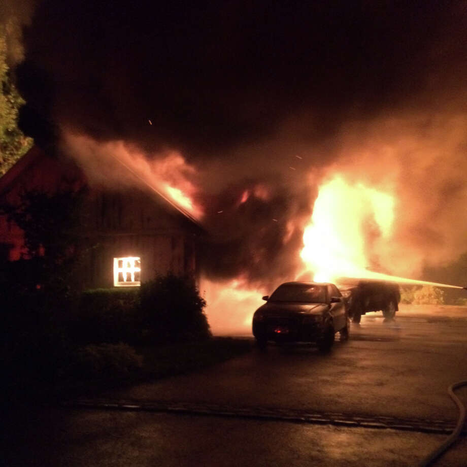 The Norwalk Fire Department responded to a garage fire at 26 Point Road, at 10:36 p.m Tuesday. The two cars parked in front of the garage were destroyed along with a vehicle and golf cart inside the garage. Photo: Contributed Photo / Norwalk Hour contributed