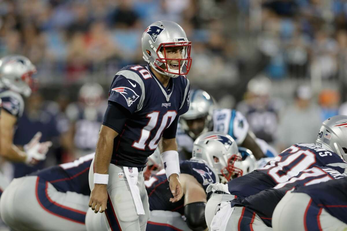 CHARLOTTE, NC - AUGUST 26: Jimmy Garoppolo #10 of the New England Patriots makes a call at the line of scrimmage against the Carolina Panthers in the 1st quarter during their game at Bank of America Stadium on August 26, 2016 in Charlotte, North Carolina. (Photo by Streeter Lecka/Getty Images)