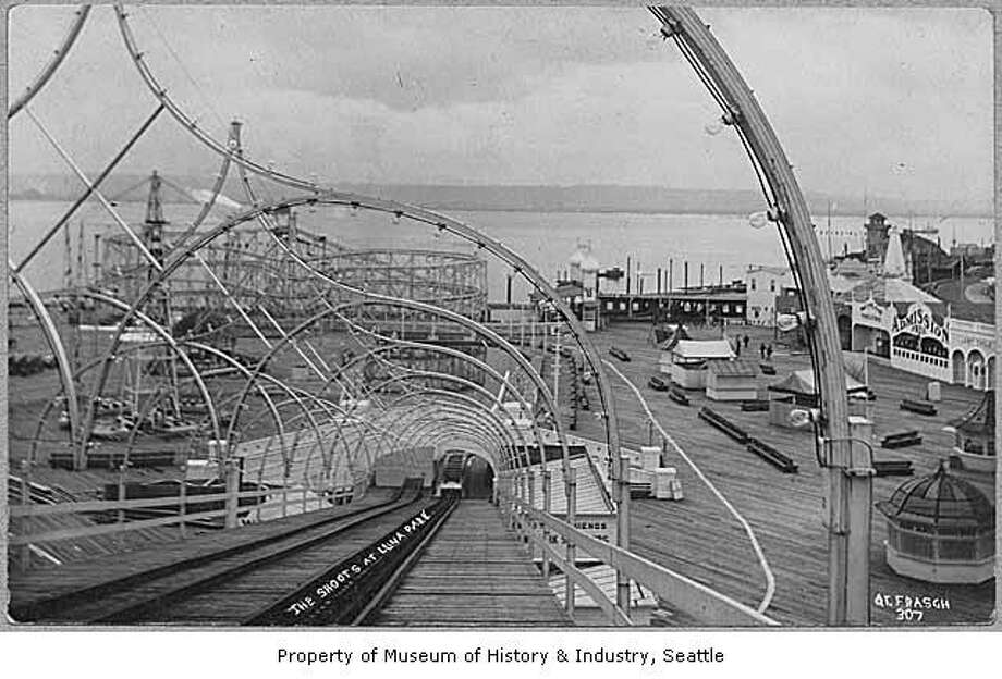 """""""West Seattle's Luna Park was named for Luna, the Roman goddess of the moon. The amusement park was a popular place for Seattleites to swim, dance, and have fun. They could ride on a giant water slide, a roller coaster, or a carousel, or have a drink at what was advertised as 'the longest bar on the bay.' They could even see an exhibit of babies in an electric incubator."""" -MOHAI. Photo, dated circa 1910, courtesy MOHAI, Seattle Historical Society Collection, image number SHS7813. Photo: Courtesy MOHAI"""