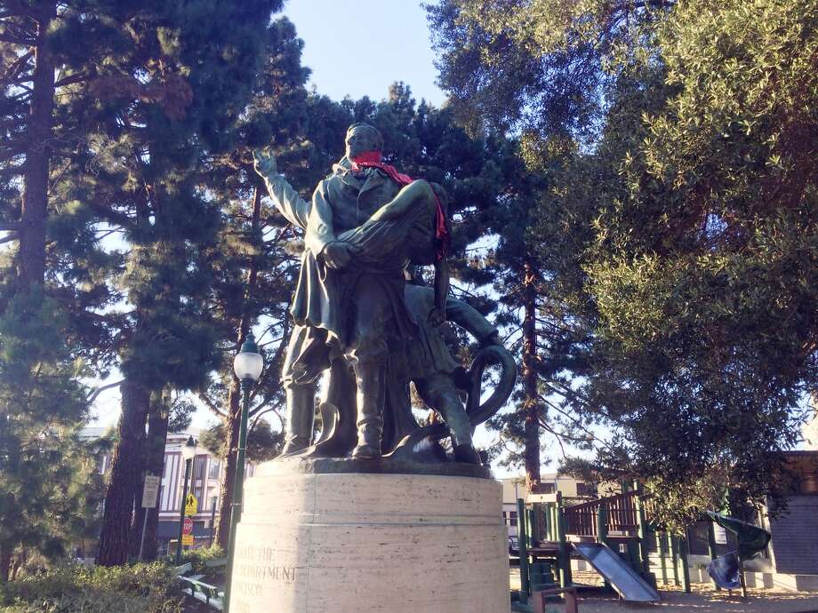 You always enjoy seeing what items people stick in the Lily Coit fireman's memorial statue firefighter's hand in Washington Square Park, or other ways people dress up the statue. Photo: Alyssa Pereira, SFGATE