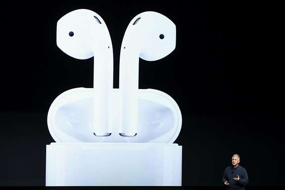 "Philip ""Phil"" Schiller, senior vice president of worldwide marketing at Apple Inc., unveils the AirPods headphones during an event in San Francisco, California, U.S., on Wednesday, Sept. 7, 2016. Apple Inc. unveiled new iPhone models Wednesday, featuring a water-resistant design, upgraded camera system and faster processor, betting that after six annual iterations it can still make improvements enticing enough to lure buyers to their next upgrade. Photographer: David Paul Morris/Bloomberg"