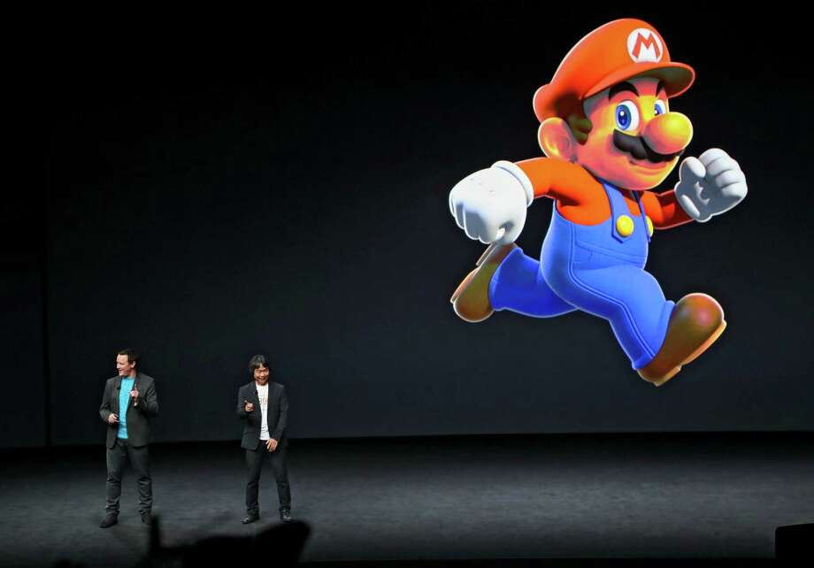 A Super Mario figure is projected during Apple's unveiling of new products, at the Bill Graham Civic Auditorium in San Francisco, Sept. 7, 2016.  Photo: JIM WILSON, NYT / NYTNS