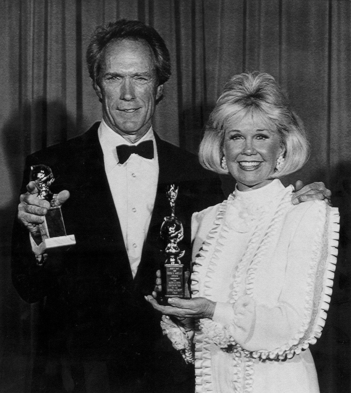 January 29, 1989: Veteran actor Clint Eastwood poses with actress Doris Day at the 46th annual Golden Globe awards in Beverly Hills.