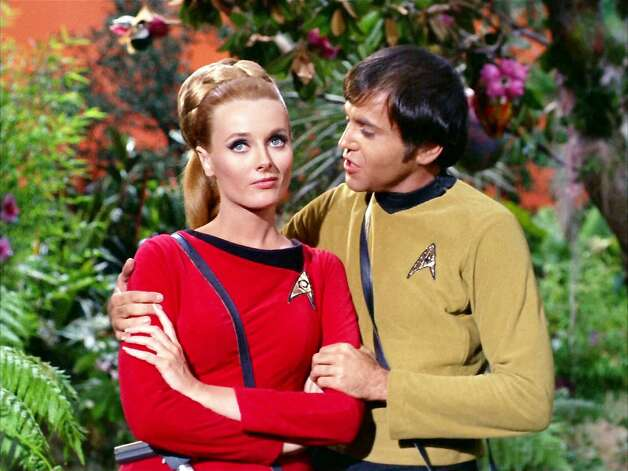 "Walter Koenigplayed Pavel Chekov, the Russian junior officer who took over the helm of the Enterprise in the second season while Takei was shooting a film. He was cast immediately because of his resemblance to Davy Jones of the Monkees, who were wildly popular at the time. Here he gets friendly with Yeoman Martha Landon (Celeste Yarnall) in the episode ""The Apple."" Photo: Getty Images, CBS Via Getty Images"