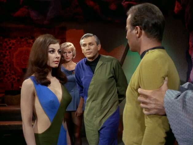"""Where do you think you're going, fella?A rule of thumb in many, if not most, """"Star Trek"""" episodes is that Kirk will become romantically involved with the character played by the beautiful guest actress — even if he's physically restrained. Photo: Getty Images, CBS Via Getty Images"""