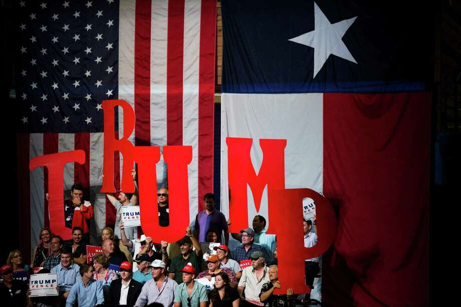 Supporters of Donald Trump, the Republican presidential nominee, hold up a sign spelling his name during a campaign event at the Travis County Exposition Center in Austin, Texas, Aug. 23, 2016. (Damon Winter/The New York Times) Photo: DAMON WINTER, NYT / NYTNS