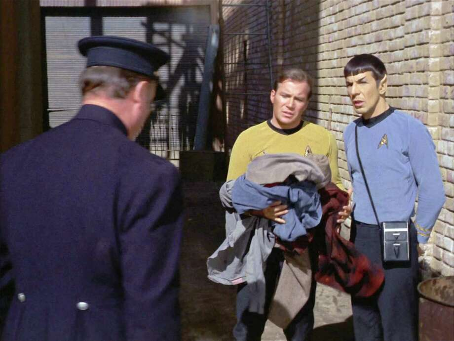 Star Trek, The Original Series, episode 'The City on the Edge of Forever' first broadcast on April 6, 1967. Seen here, from left to right, Hal Baylor (back to camera, as Policeman), William Shatner (as Captain James T. Kirk) and Leonard Nimoy (as Mr. Spock) in year 1930. Image is a screen grab. Photo: CBS Photo Archive, Contributor / 1967 CBS Photo Archive