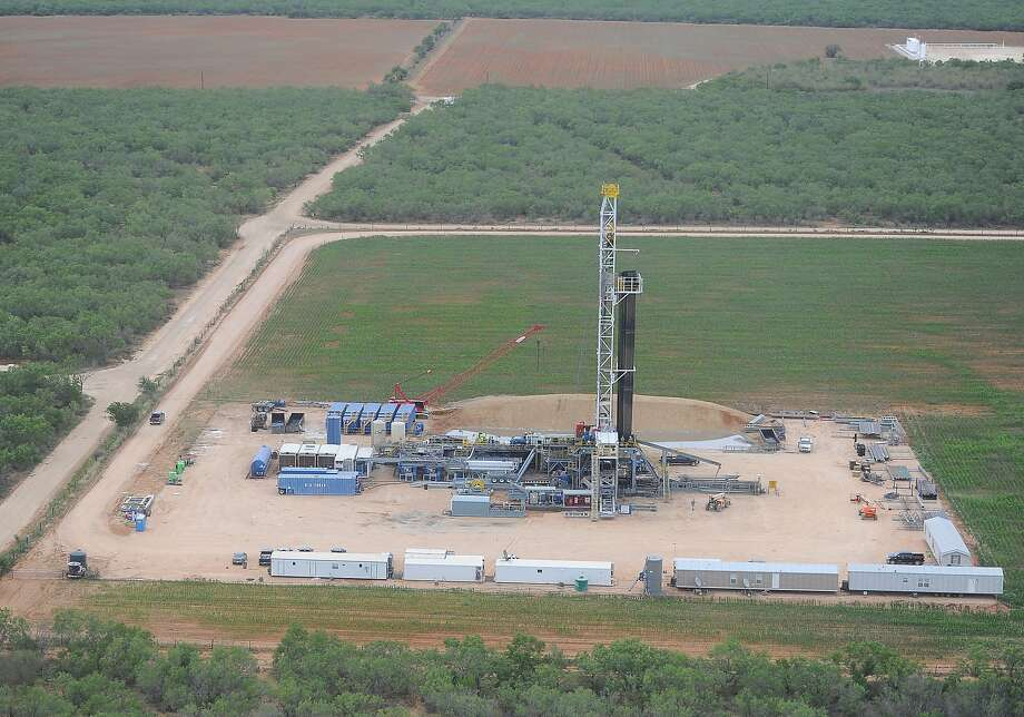 An aerial view shows  drilling activity at a  Carrizo Oil & Gas wells in northern LaSalle County. Photo: Carrizo Oil & Gas