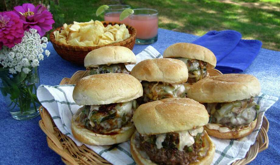 This Aug. 16, 2016 photo shows beer-steamed chili cheeseburgers in Ashby, Mass. This dish is from a recipe by Sara Moulton. (Sara Moulton via AP) ORG XMIT: MASM101 Photo: Sara Moulton / Sara Moulton