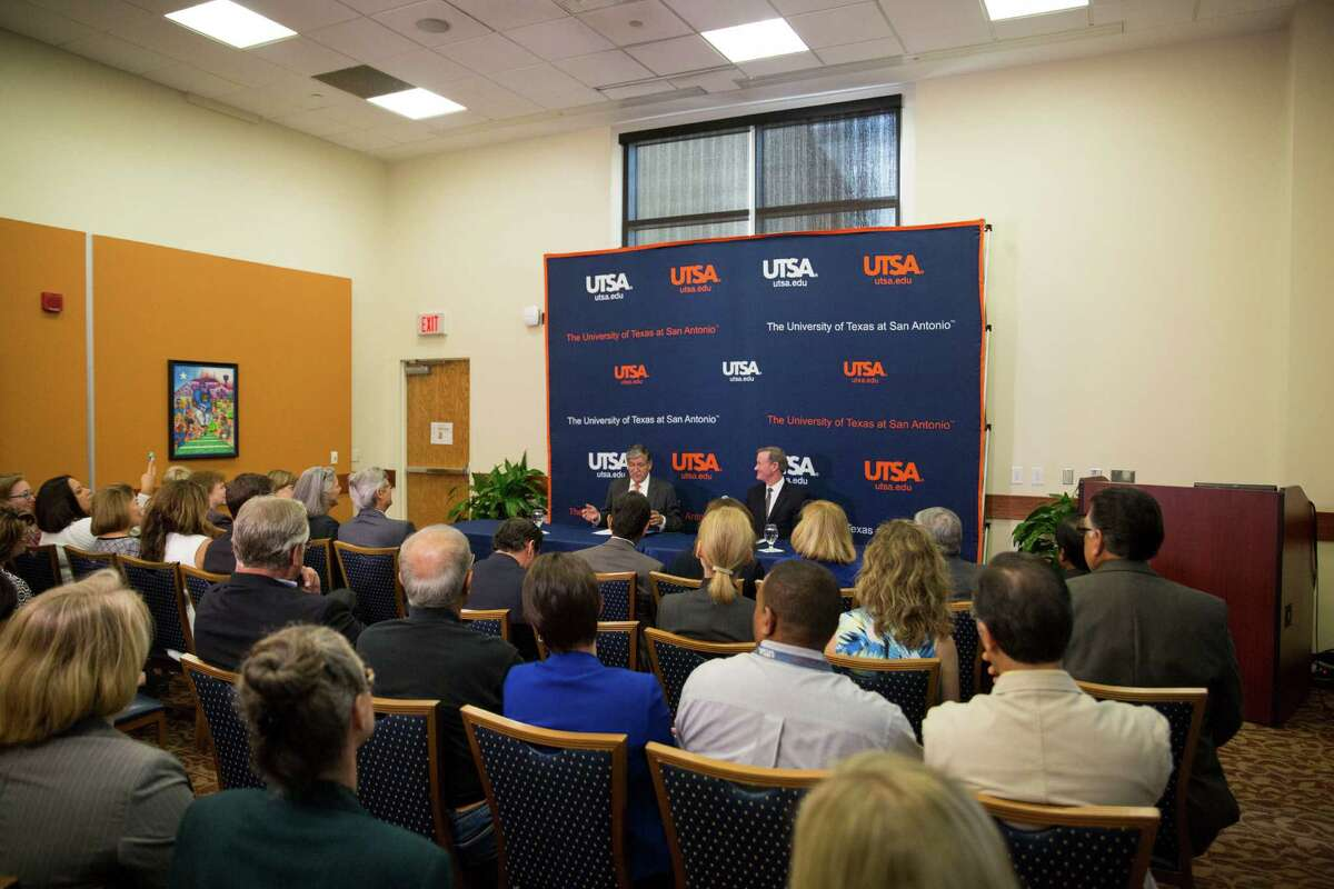 University of Texas System Chancellor William H. McRaven, right, sits with University President Ricardo Romo as Romo talks about his retirement during a press conference at the H-E-B University Center at the University of Texas at San Antonio on September 7, 2016.