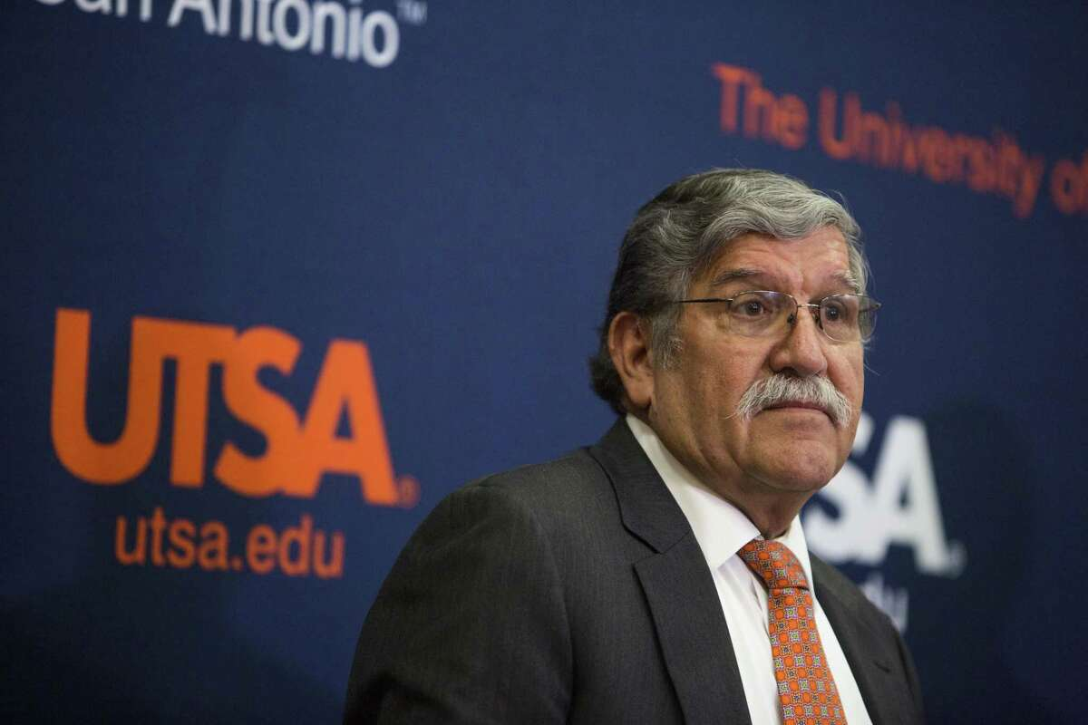University President Ricardo Romo talks about his retirement during a press conference at the H-E-B University Center at the University of Texas at San Antonio recently. There are still unanswered questions about his departure.