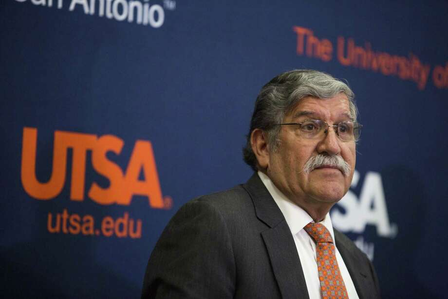 University President Ricardo Romo talks about his retirement during a press conference at the H-E-B University Center at the University of Texas at San Antonio recently. There are still unanswered questions about his departure. Photo: Carolyn Van Houten /Carolyn Van Houten / 2016 San Antonio Express-News