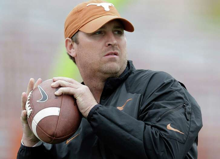 Texas offensive coordinator Sterlin Gilbert works with players before the spring game on April 16, 2016, in Austin.
