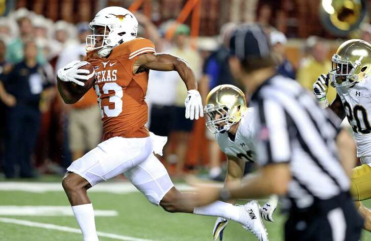 Longhorns receiver Jerrod Heard speeds toward the end zone after a long catch as Texas hosts Notre Dame at Royal-Memorial Stadium on Sept. 4, 2016. Heard was tripped up just before the goal line.