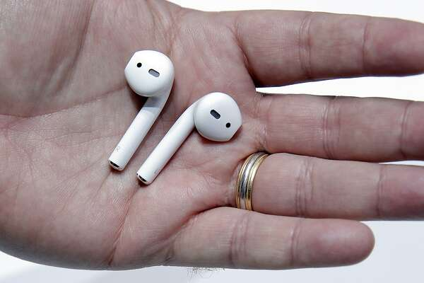 Apple Airpods are displayed during an Apple Event to announce new products at the Bill Graham Civic Auditorium in San Francisco, Calif., on Wednesday, September 7, 2016.
