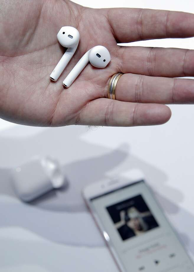 Apple's AirPods are displayed during an event at the Bill Graham Civic Auditorium in San Francisco in September. After a lengthy delay, people can now order AirPods online, and they will be in stores next week. Photo: Carlos Avila Gonzalez, The Chronicle