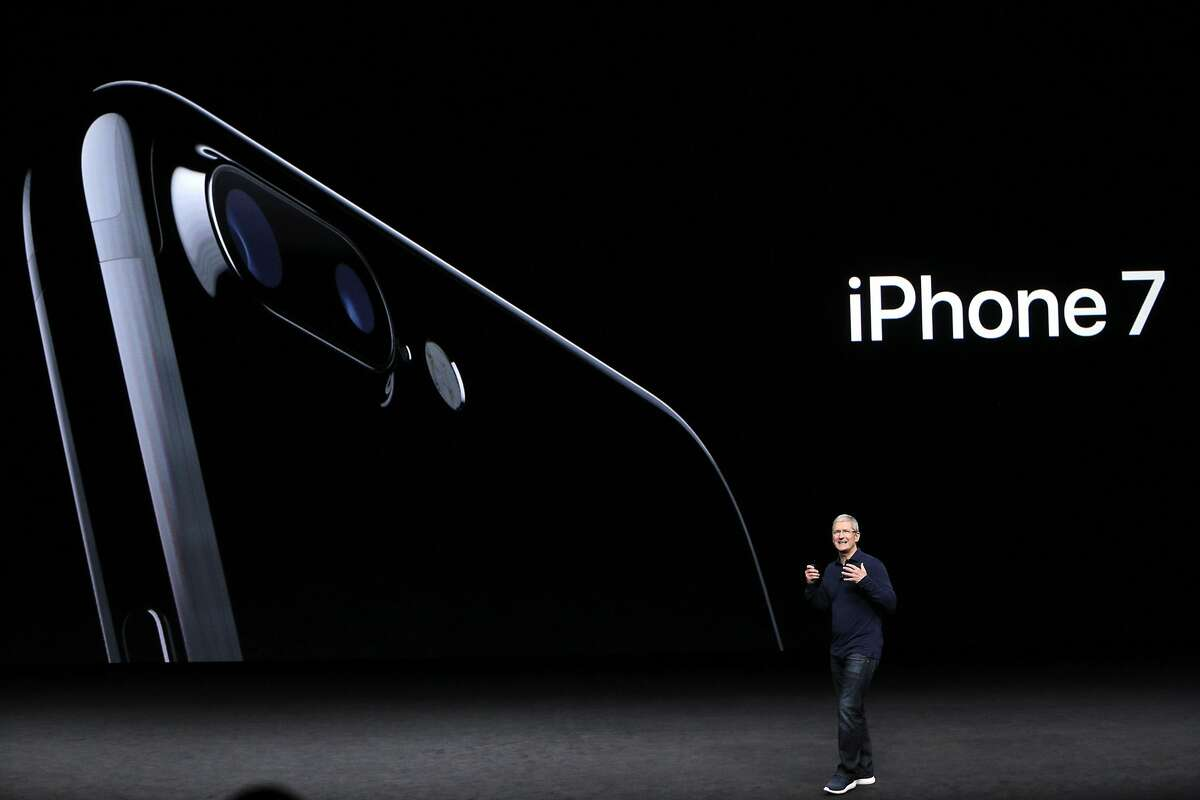 Apple CEO Tim Cook introduces the new iPhone 7 during an Apple Event to announce new products at the Bill Graham Civic Auditorium in San Francisco, Calif., on Wednesday, September 7, 2016.