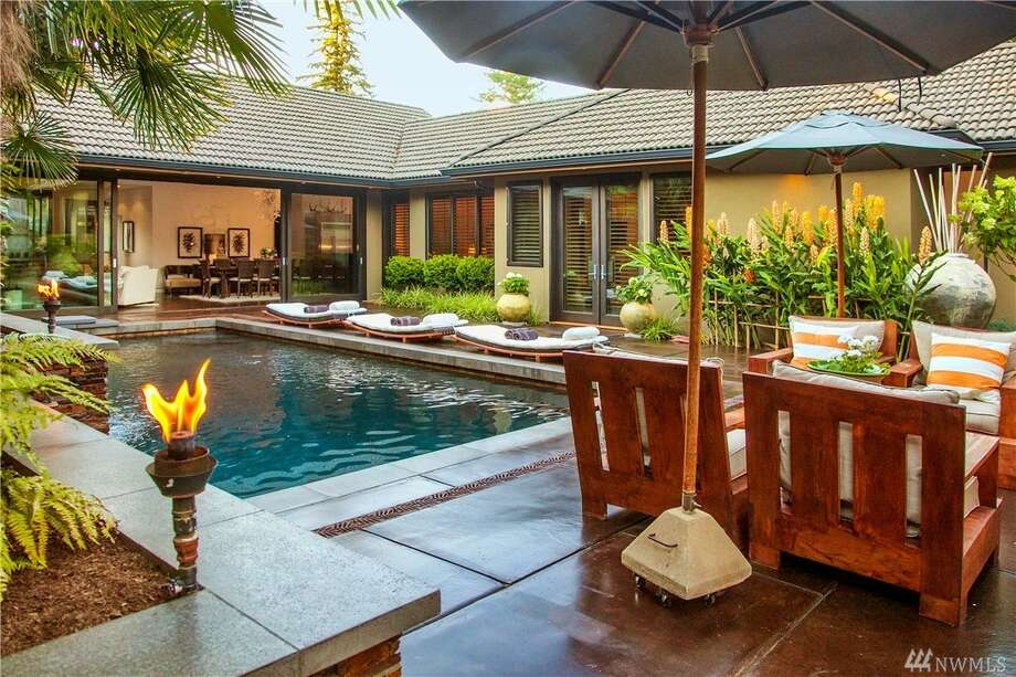 The home is listed for $2.175 million. It has four bedrooms, 3¼ bathrooms and a covered pavilion by the pool. The listing agent, Scott Wasner, said the owner designed the home himself and has owned the property for 19 years. He tore it down in 2007 and completely rebuilt it from the ground up.You can see the full listing here. Photo: Photos By Mel Curtis, Listing Courtesy Scott Wasner, Realogics Sotheby's